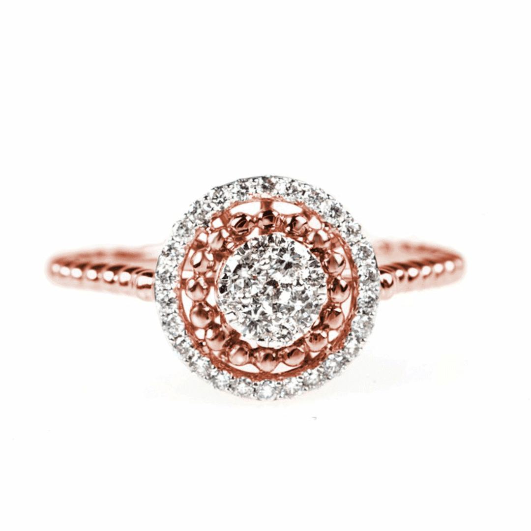 Pierścionek z różowego złota z diamentami w filigranowej oprawie.