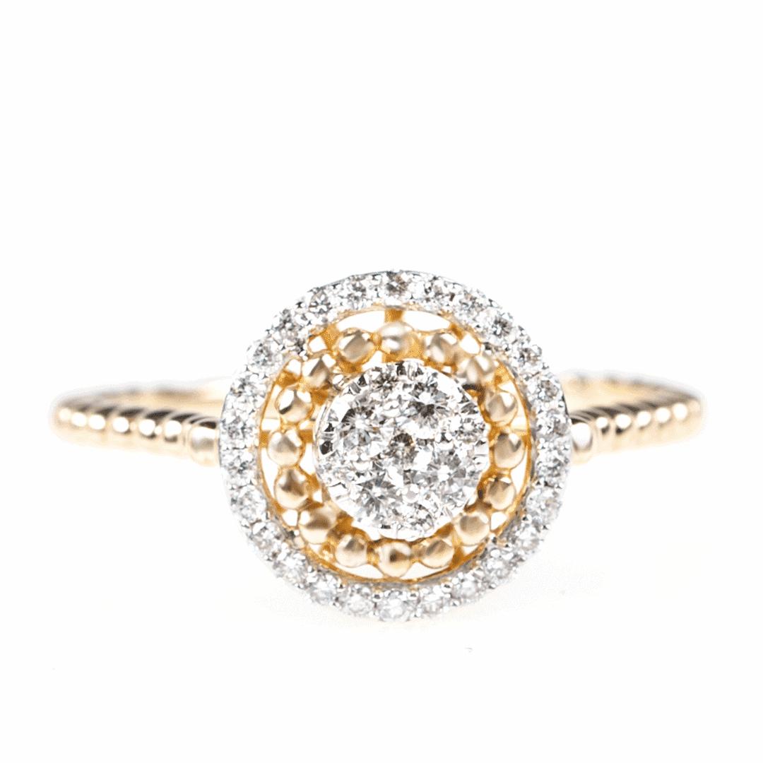 Pierścionek z żółtego złota wysadzany migotliwymi diamentami w oprawie z delikatnych kulek