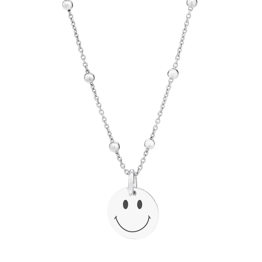 Srebrny naszyjnik z zawieszką uśmiechem.